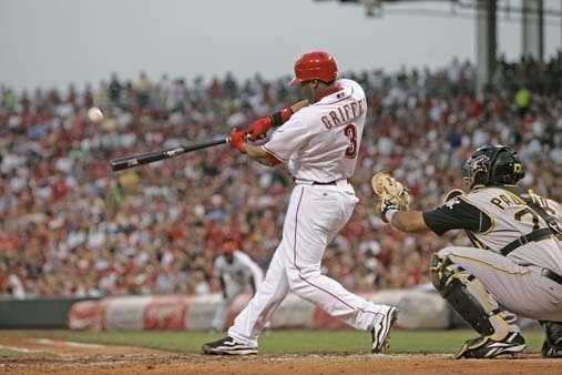 Cincinnati Reds' Ken Griffey Jr. hits a home run in a baseball game against the Pittsburgh Pirates, Friday, May 25, 2007, in Cincinnati. Catcher Ronny Paulino is at right. It was the 574th career home run for Griffey, moving him past Harmon Killebrew into eighth place on the all-time list.