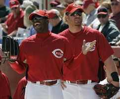 Cincinnati Reds outfielders Ken Griffey Jr., left, and Adam Dunn wait to go onto the field during a spring training baseball game against the Tampa Bay Rays, Friday, Feb. 29, 2008, in Sarasota, Fla.