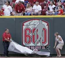 A banner honoring Cincinnati Reds' Ken Griffey Jr. for his 600th career home run is unveiled during ceremonies prior to the Reds' baseball game against the Los Angeles Dodgers, Tuesday, June 17, 2008, in Cincinnati.