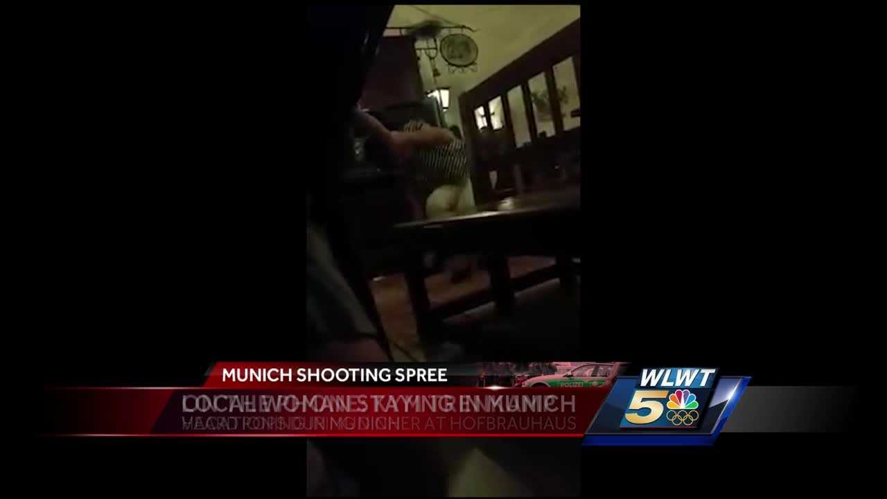 A terrifying video shows a Mariemont woman diving under a table after hearing pops in a restaurant Friday in Munich, where authorities said a terror attack may have been carried out.