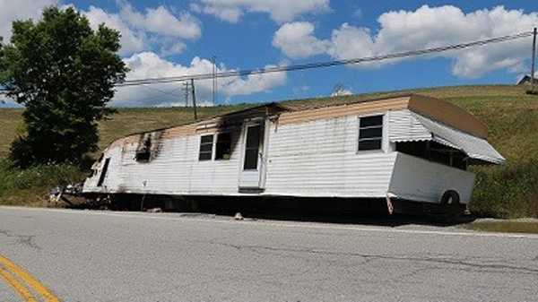 A mobile home was abandoned on the side of a Pendleton County highway and then caught fire, county officials said.
