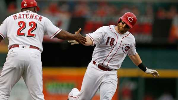 Cincinnati Reds Tucker Barnhart (16) is congratulated by third base coach Billy Hatcher (22) as he rounds the bases with a grand slam home run off Miami Marlins starting pitcher Jose Urena during the first inning of a baseball game, Tuesday, Aug. 16, 2016, in Cincinnati. (AP Photo/Gary Landers)