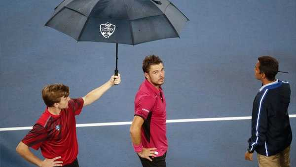 Stan Wawrinka, of Switzerland, waits for a rain delay to be called during his match against Jared Donaldson, of the United States, during the Western & Southern Open tennis tournament, Tuesday, Aug. 16, 2016, in Mason, Ohio. (AP Photo/John Minchillo)
