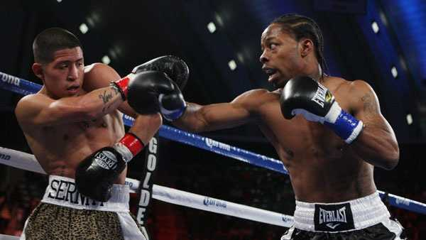 Rau'Shee Warren, right, of the United States, throws a punch at Richard Hernandez, of United States, in the first round of the bantamweight boxing match in Atlantic City, N.J., on Saturday, Feb. 16, 2013. Warren won in the second round. (AP Photo/Tim Larsen)