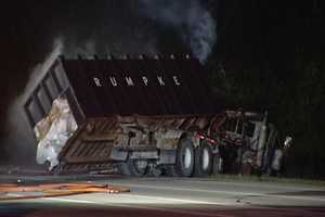 A fiery head-on collision between a garbage truck and a car closed Interstate 275 in Springdale for hours Saturday morning.