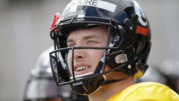 Cincinnati's Hayden Moore stands on the sidelines during their spring NCAA college football game, Saturday, April 2, 2016, in Cincinnati. (AP Photo/John Minchillo)