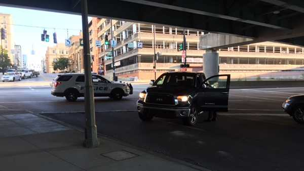 A pedestrian suffered life-threatening injuries when she was struck by a car downtown Friday morning.