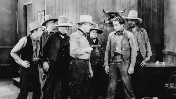 """William Boyd points his gun at Clark Gable in scene from the 1929 Pathe film """"Painted Desert."""" At the time, Boyd --perhaps better known in the role of Hopalong Cassidy--was a star, while Gable, a new actor in Hollywood, had a bit part. (AP Photo)"""