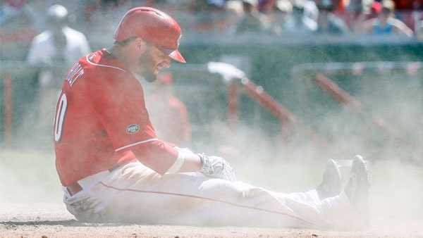 Cincinnati Reds' Tyler Holt reacts after being tagged out at home by St. Louis Cardinals catcher Yadier Molina in the seventh inning of a baseball game, Sunday, Sept. 4, 2016, in Cincinnati. (AP Photo/John Minchillo)