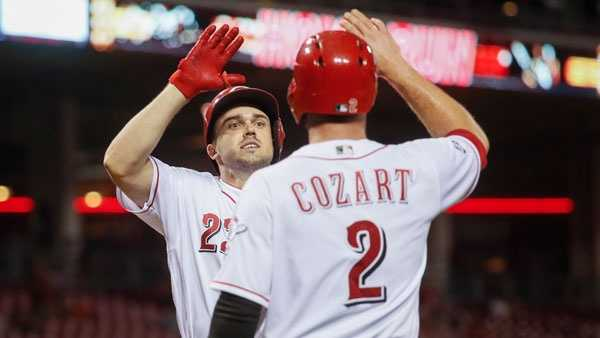 Cincinnati Reds' Adam Duvall, left, celebrates with Zack Cozart (2) after hitting a two-run home run off New York Mets pitcher Rafael Montero in the third inning of a baseball game, Tuesday, Sept. 6, 2016, in Cincinnati. (AP Photo/John Minchillo)