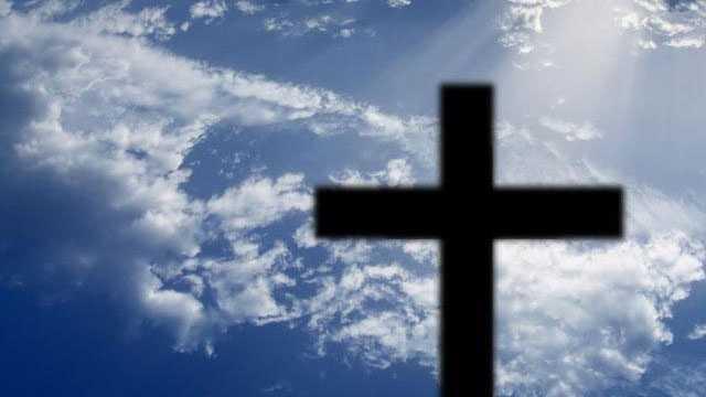 religion cross against blue sky