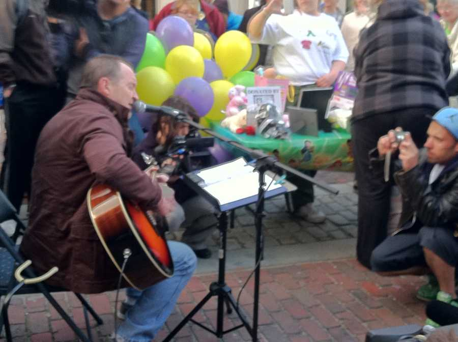 People gathered around to hear a song written for Ayla.