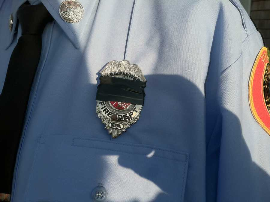 Police officers have covered their badges in black in memory of Greenland Police Chief Michael Maloney.