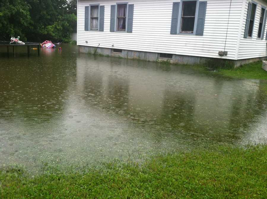 Water has surrounded this house in Auburn.