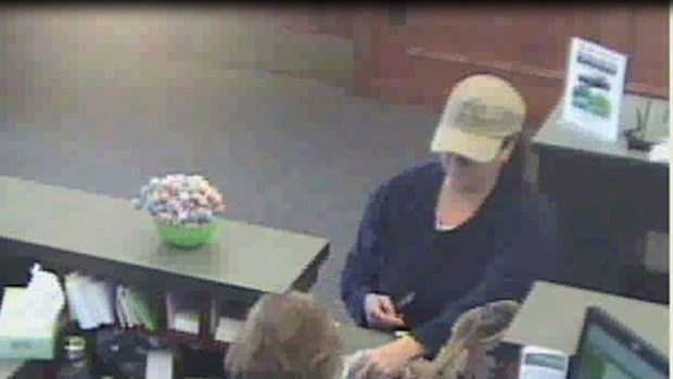 This is a surveillance picture from last month's robbery of the Kennebunk Savings Bank in York.  Police believe the same woman is responsible for a bank robbery in New Hampshire.