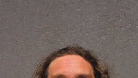 Terry Woodward, of Newport, is accused of robbing a bank in Massachusetts.