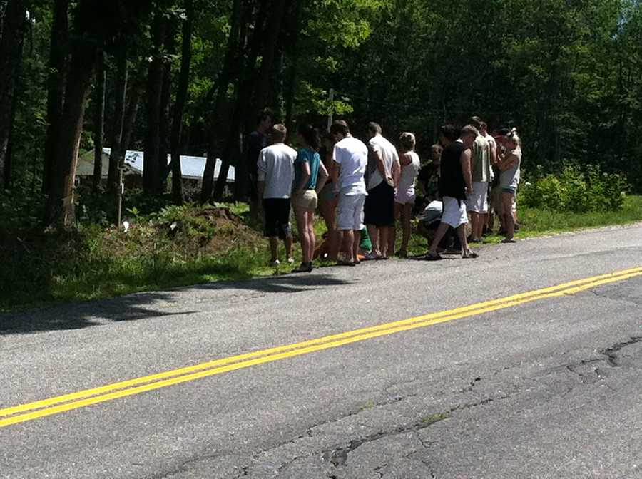 Friends of the victims gathered near the crash site on Tuesday.