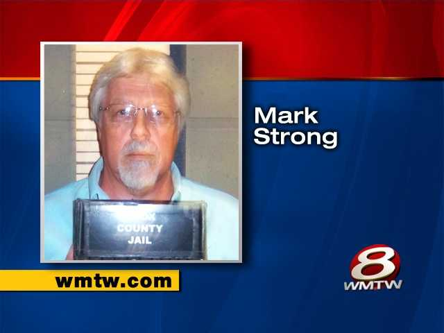 Mark Strong is charged with promoting prostitution.
