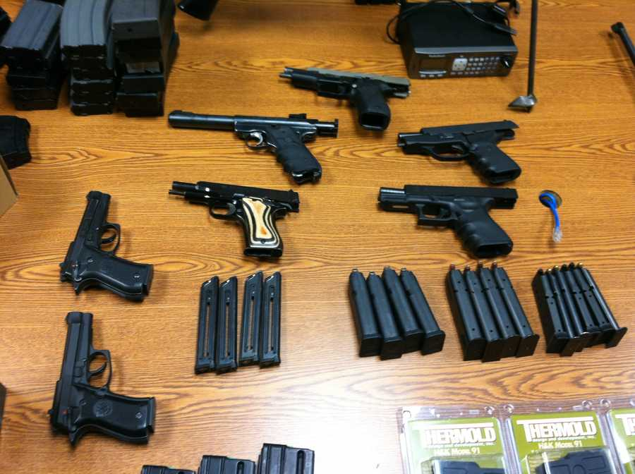 Police say they searched Courtois' home and found several more guns, including a machine gun, and thousands of rounds of ammunition.