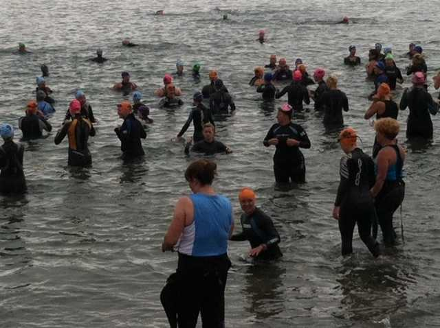 Women testing out the water of Casco Bay ahead of Sunday's race.