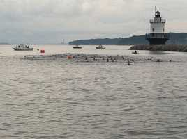 The first group of swimmers is off.