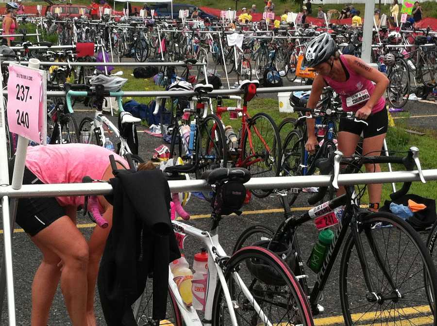 Athletes shed their wet suits in favor of bike helmets for the next stage of the race.