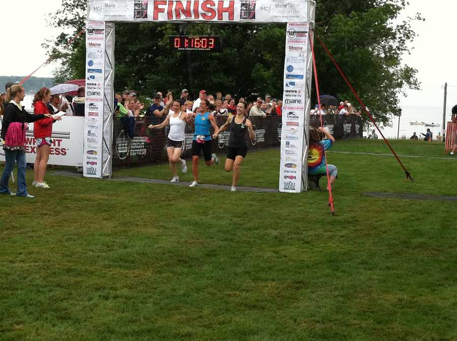 An athlete, who's among the first to cross the finish line.