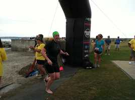 News 8 Meteorologist Mallory Brooke exits the water after swimming one-third of a mile.