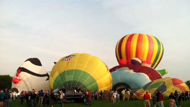 Several balloons being inflated and getting ready to launch