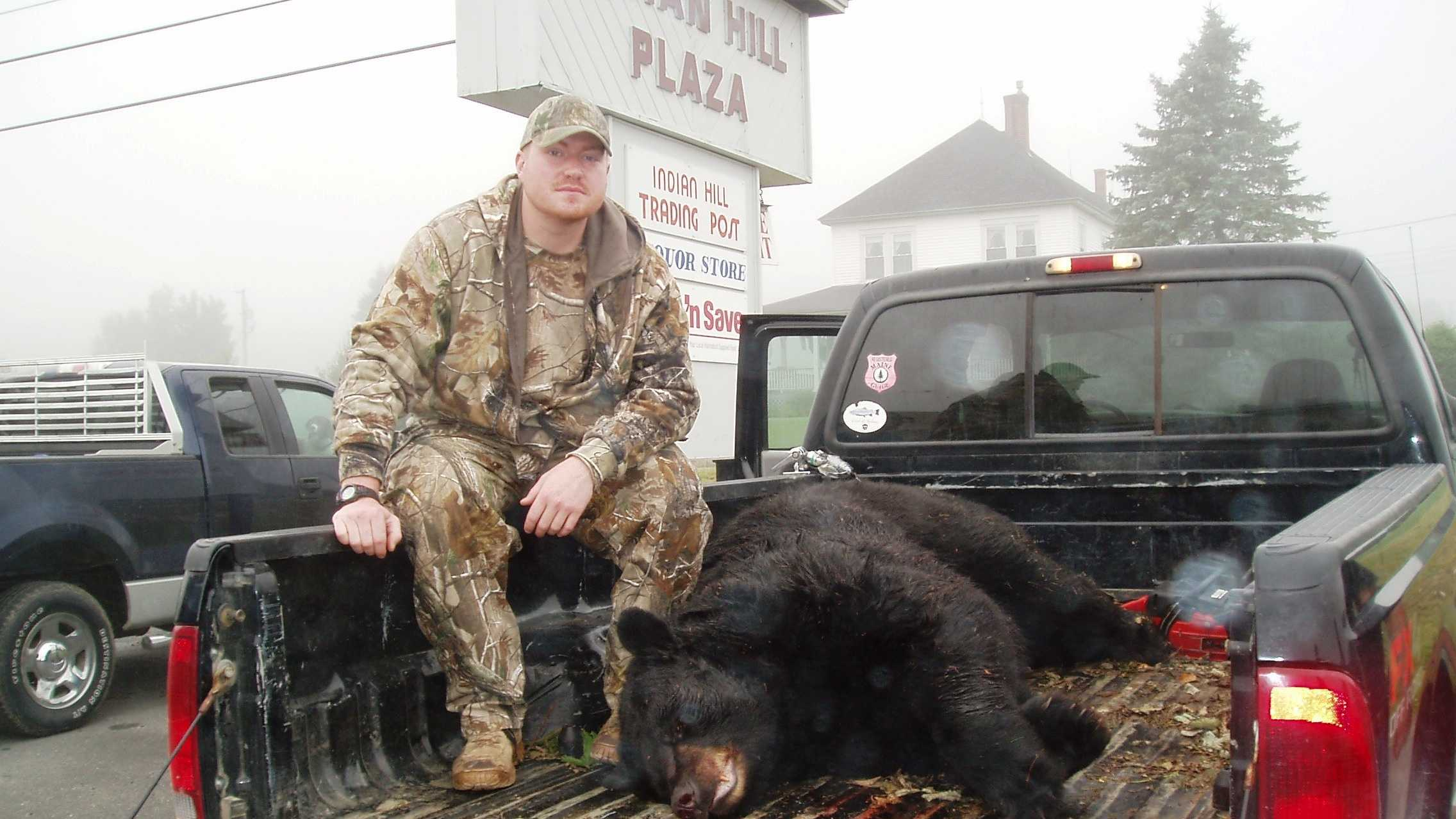 Matt Knox of Waynesboro, Pennsylvania and his bear catch weighing in at a record 699-pounds.