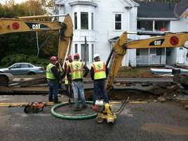 Officials said a crew installing a new gas line hit the water main Monday afternoon.