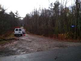 Crews were at Flaggy Meadow Road in Buxton on Tuesday morning, which was closed because of downed power lines.