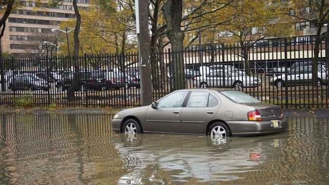 Car in flooded road, Jersey City, NJ, Hurricane Sandy