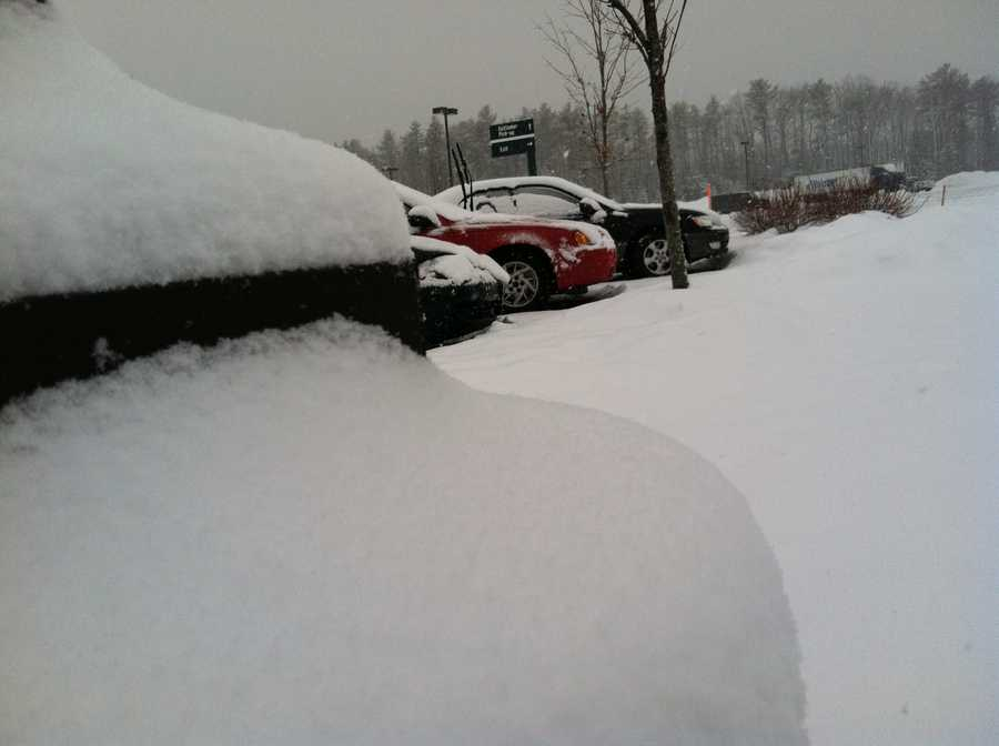 Snow piles up on cars in Scarborough.