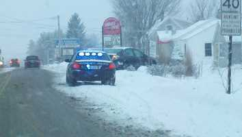A car slides off the road in Westbrook.