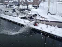 Clearing the snow from DiMillo's Marina in Portland.