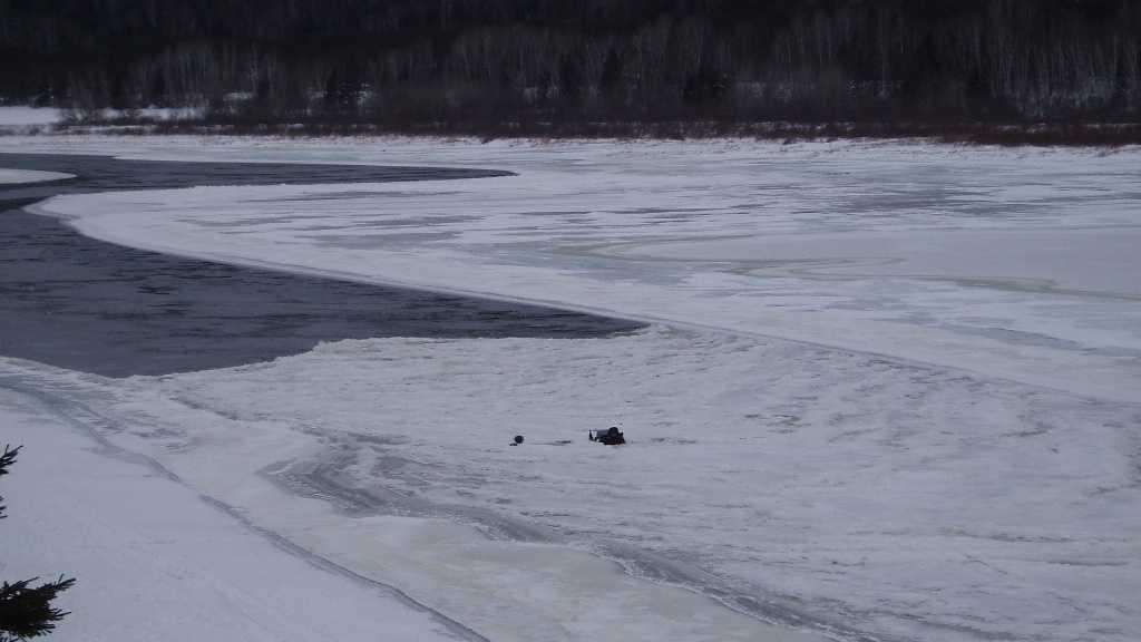 Snowmobile in river