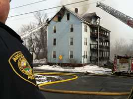 The fire damaged a four-story apartment building at the corner of Washington and Penobscot streets.