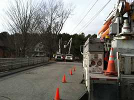 Power crews work to restore power in Bath.