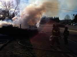 Crews in Portland battled a brush fire Tuesday afternoon at the intersection of Kennebec Street, Marginal Way and Forest Avenue.