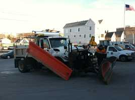 Portland Public Services crews prepare the plows for Friday's storm.