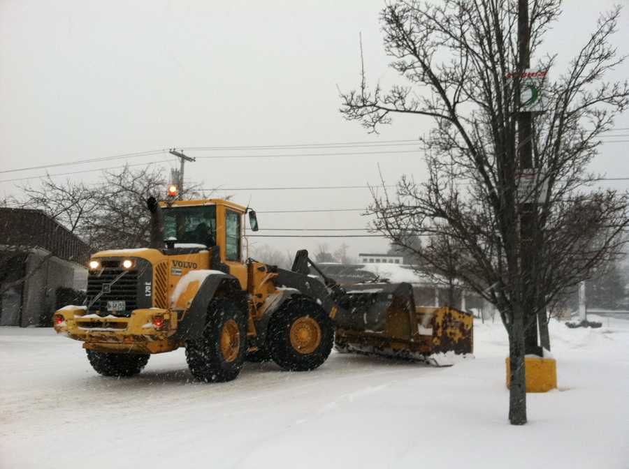 Crews work to clear the snow in Portland.