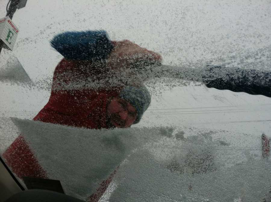 News 8 photographer Jon Cole scraping the ice from our news vehicle