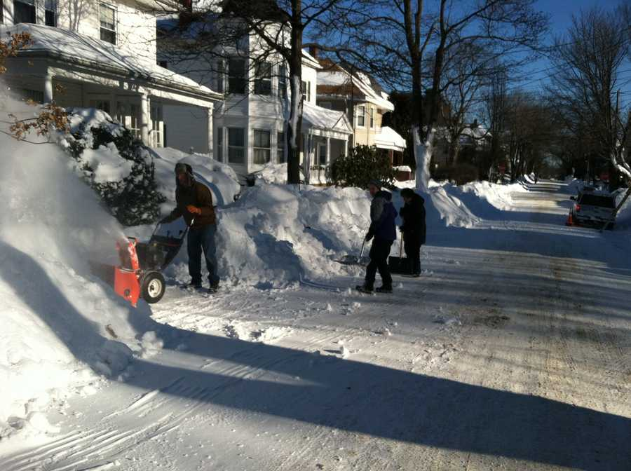People digging out in Portland on Sunday.