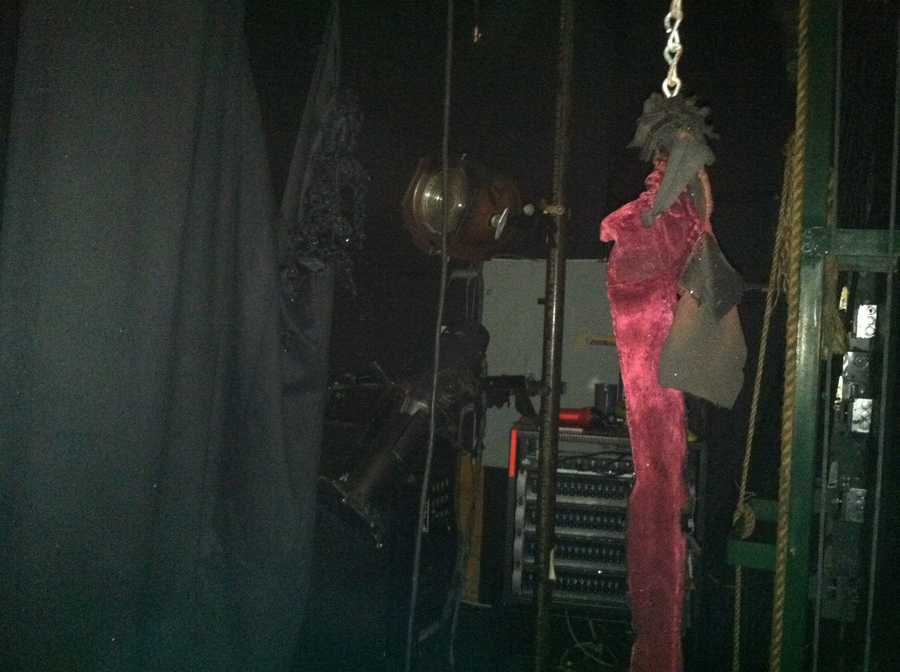 Red curtain caught fire. School officials say this theater light was too close to curtain.