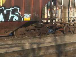 A company official said that five cars carrying feed derailed, and as of 10:30 a.m., all of the cars were upright and all but one were back on the track.