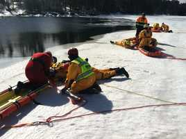 Fire and rescue workers from seven states and Canada were on Sebago Lake in Standish Friday learning rescue techniques on ice.