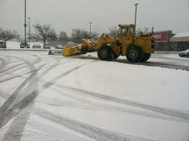 Plow clears snow from this parking lot in Windham on Wednesday