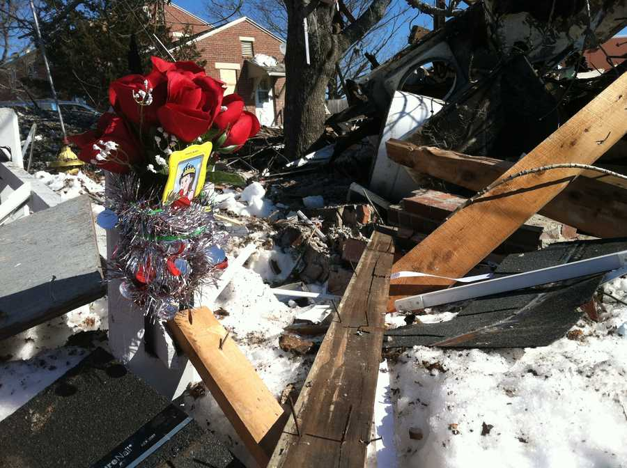 A massive explosion killed a woman in Bath and destroyed an apartment house. Three others were injured.