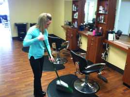 Darcy Ames, owner of Perfect Image hair salon in Auburn - closing early today. Half of her 40 clients have cancelled appointments. The snow storms have hurt her bottom line, she said.